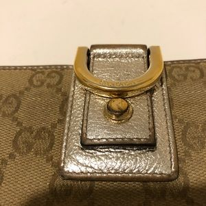 Gucci wallet in metallic leather and GGfabric